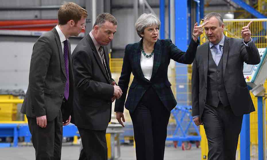 theresa_may_touring_iko_polymeric's_production_facility